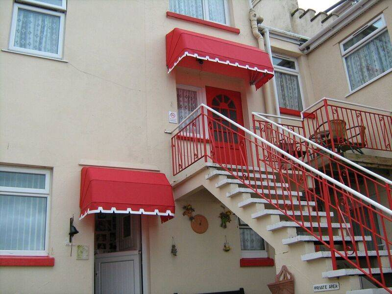 Doorways with red canopy blinds