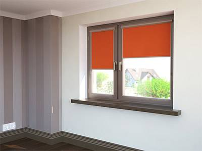orange roller blinds partially covering windows