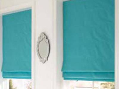 Turquoise roman blinds in white room