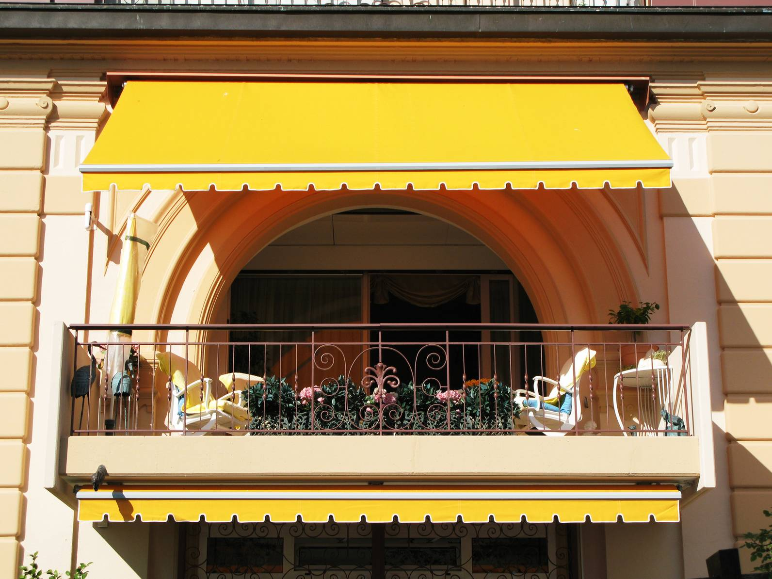 Balcony of luxury hotel with yellow canopy blinds