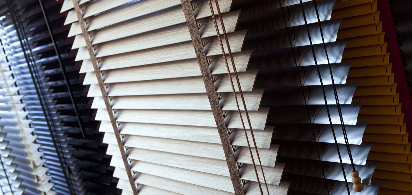 selection of venetian blinds of various colours